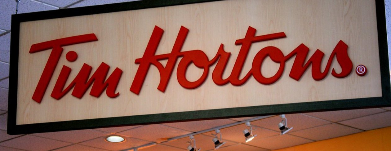 Tim Hortons store sign. Credit: miss_rogue / Flickr